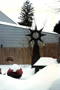 Melded steel sculpture by Dave Fontana, outside his mother's house after a snow storm