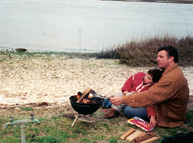 Dave Fontana and son Aidan roasting marshmallows in Chincoteague, Virginia in April 2001